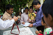 27 year old Sri Chandi Barmon and his extended family arrive at a government compound in the town of Debiganj to sign documents. Originally they asked if they could go to India after the disbanding of the enclaves but later changed their mind and decided to stay. Their request was allowed and formalised on this day.<br /> <br /> On July 31st 2015 the enclaves that formed one of the world's most complicated borders were officially absorbed in to the countries that surrounded them in a land-mark land swap between India and Bangladesh. The people that lived in them will finally receive citizenship.<br /> <br /> Enclaves are small pockets of sovereign land completely surrounded by another sovereign nation. Approximately 160 enclaves, known as chitmahals, exist on either side of the India-Bangladesh border. For 68 years the 50,000 plus inhabitants of these enclaves have lived a difficult existence, stranded from their home nation and ignored by the country that surrounds them. <br /> <br /> In theory even leaving their enclaves is illegally crossing an international border and for decades it has been very difficult for them to receive even the most basic of rights whether education or health. Even the police have no jurisdiction in the enclaves leaving them essentially lawless.