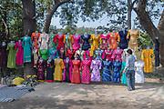 Selling colourfull dresses along Jabalpur Road, Jabalpur, Madhya Pradesh, India.