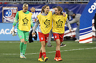 26 October 2014: Former University of North Carolina Tar Heels (from right) Heather O'Reilly (USA), Tobin Heath (USA), and Ashlyn Harris (USA). The United States Women's National Team played the Costa Rica Women's National Team at PPL Park in Chester, Pennsylvania in the 2014 CONCACAF Women's Championship championship game. By advancing to the final, both teams have qualified for next year's Women's World Cup in Canada. The United States won the game 6-0.