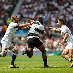 Semi Radradra of the Barbarians takes on Chris Robshaw and Henry Trinder of England