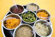 """Condiments at the """"Donghai Gong"""" translates as Donghai Palace, restaurant in Sanya, China. Various chili peppers (the yellow one is Hainan pepper, famed to be super spicy)  and garlic to be eaten with fish and meat."""