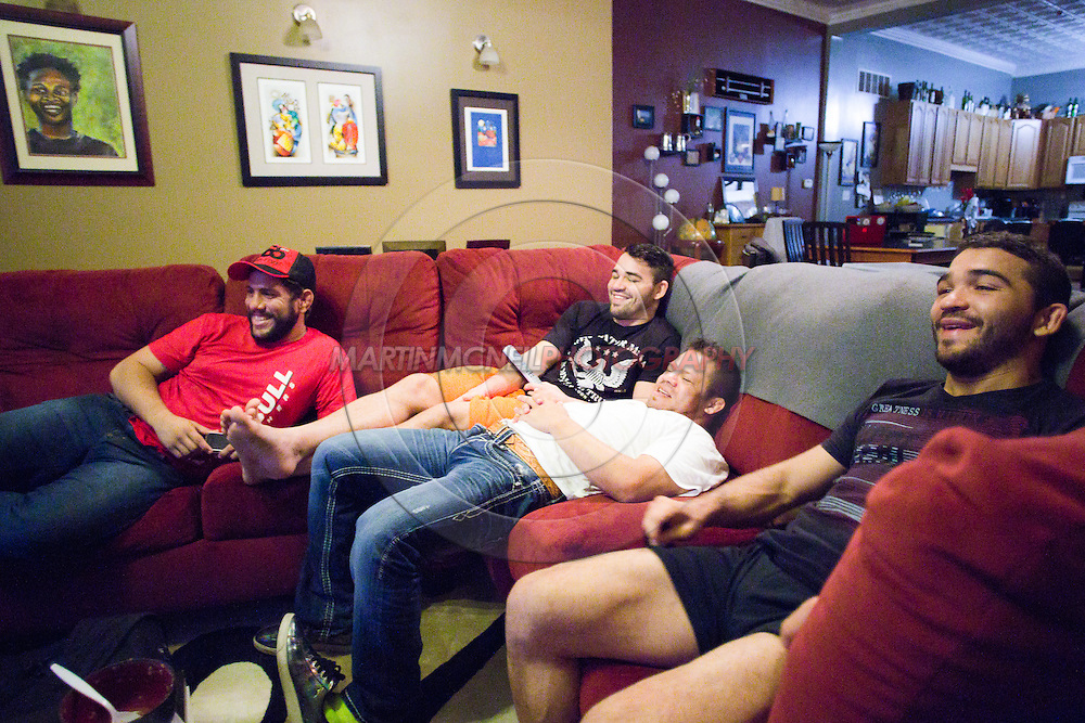 "ST. LOUIS, MO, JUNE 15, 2015: Patricio ""Pitbull"" Freire (R) and his teammates relax whilst watching television ahead of his fight at Bellator 138 in St. Louis, Missouri © Sara Levin"