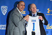 Mick Cronin, right, and athletic director Dan Guerrero pose with No. 1 jersey as Cronin is introduced as UCLA Bruins new head basketball coach at a news conference on the campus in Los Angeles Wednesday, April 10, 2019. Cronin was hired as UCLA's basketball coach Tuesday, ending a bumpy, months-long search to find a replacement for the fired Steve Alford. The university said Cronin agreed to a $24 million, six-year deal. (Dylan Stewart/Image of Sport)