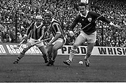 07/09/1975<br /> 09/07/1975<br /> 7 September 1975<br /> All-Ireland Hurling Final: Kilkenny v Galway at Croke Park, Dublin. <br /> Two to one. Galway's left full-back, Pat Lally, takes on two Kilkenny forwards, Pat Delany (left) and Mick Brennan (center), near the side line.