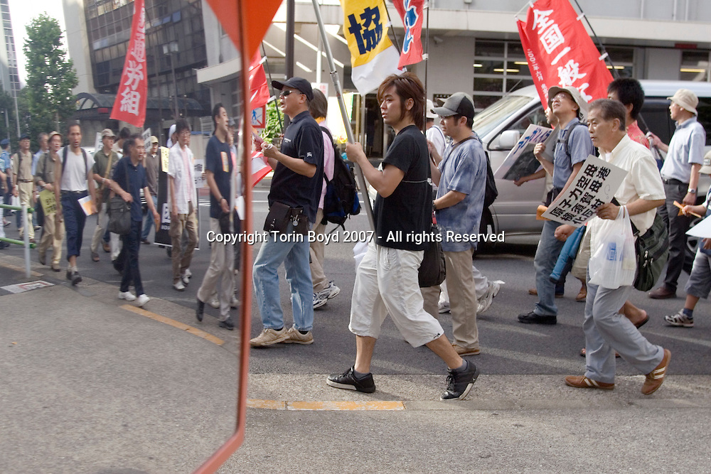 "This is ""Peace Day Tokyo 2007"", an antiwar rally held in central Tokyo on Sept. 15, 2007, part of the worldwide International Day of Peace Peace (officially Sept. 21, 2007). This was attended by about 1500 people to protest nuclear weapons and the US led wars in Iraq and Afghanistan. But more importantly this was to protest Japan's participation in the US led wars for over the past six years Japan has been providing logistical support to these wars at the urging of the US. This includes rebuilding efforts by the Japan Ground Self Defense Force in Samawa Provence, Iraq since 2004, as well refueling US naval ships by the Japan Maritime Self Defense Force in the Indian Ocean off Afghanistan since 2001. This specially enacted antiterrorism refueling mission is a major controversy within Japanese politics as the ruling Liberal Democratic Party (LDP) wants to renew this legislation which expires on November 1, 2007. But the main opposition party, the Democratic Party of Japan which took control of the Upper House of Parliament in late July, 2007 wants to defeat this bill and is one of the main reasons why outgoing Prime Minister Shinzo Abe abruptly announced his resignation on Sept. 12, 2007. After the end of WW II, Japan became a pacifist nation enacting Article 9 of it's constitution which forbids it to attack any other nation. But Japan's political power brokers now want to rearm Japan by revising Article 9, much to the chagrin of its Asian neighbors."