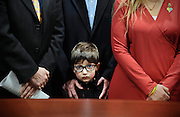 Hayden Lewis, of Norwalk, Conn., cousin of Sandy Hook School shooting victim Jesse Lewis, stands with family during a news conference at the Legislative Office Building in Hartford, Conn. Connecticut's congressional delegation is backing federal legislation that would honor Lewis and provide expanded support to train teachers in social and emotional learning. (AP Photo/Jessica Hill)