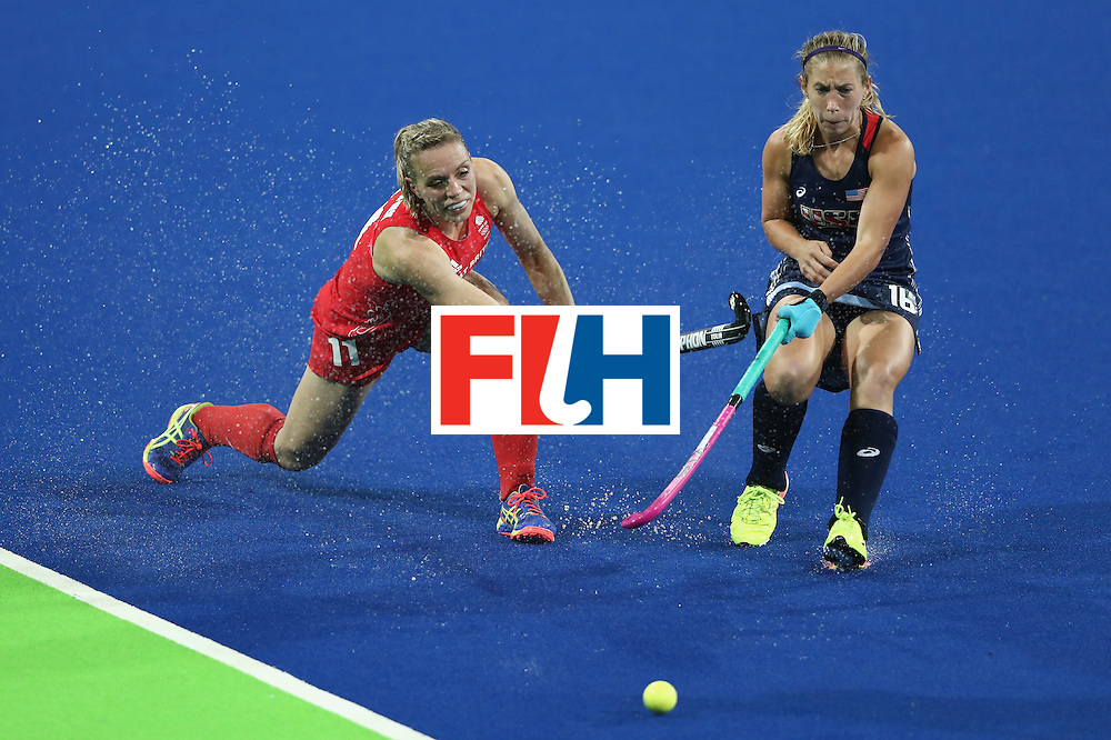 RIO DE JANEIRO, BRAZIL - AUGUST 13:  Kate Richardson-Walsh of Great Britain plays the ball past Katie Bam during the Women's group B hockey match between Great Britain and the USA on Day 8 of the Rio 2016 Olympic Games at the Olympic Hockey Centre on August 13, 2016 in Rio de Janeiro, Brazil.  (Photo by David Rogers/Getty Images)