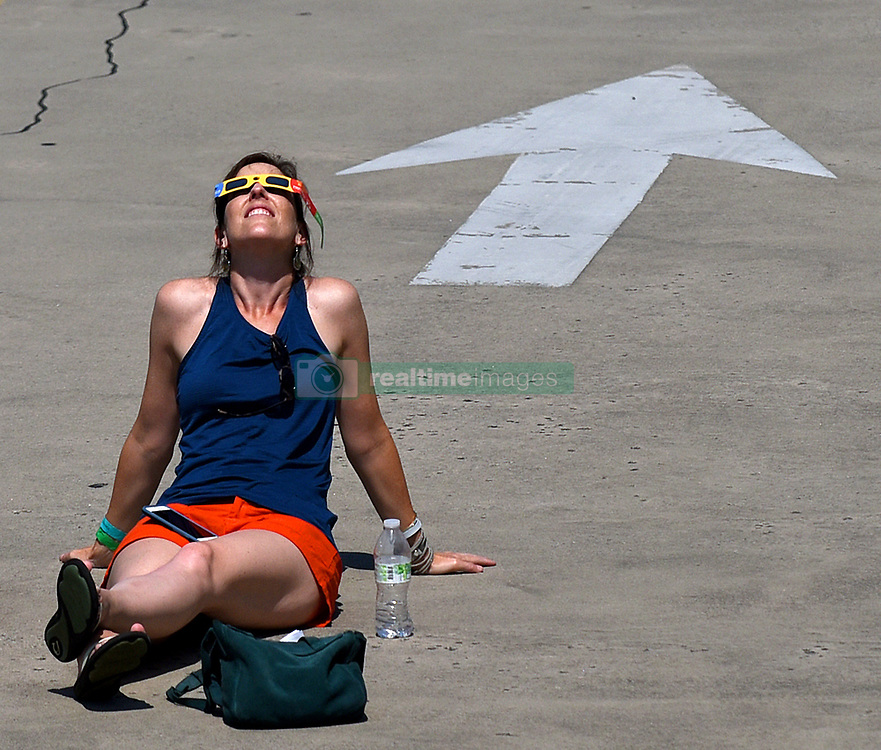 Tonya Carinelli of Charlotte, N.C. basks in the solar eclipse while reclined at the Discovery Place parking deck on Monday, Aug. 21, 2017 in Charlotte, N.C. Photo by Jeff Siner/Charlotte Observer/TNS/ABACAPRESS.COM