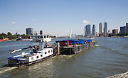 Shipping on the River Maas with modern skyscrapers in the background, Rotterdam, Netherlands