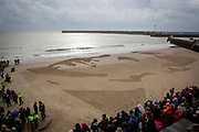 "The Poet & Soldier Wilfred Owen's face drawn on the beach in Folkestone as part of Danny Boyle's 'Pages of the Sea""  Armistice Day event commemorating 100 years since the end of the First World War on remembrance day the 11th of November 2018. Sunny Sands beach, Folkestone, Kent, United Kingdom.  (photo by Andrew Aitchison / In pictures via Getty Images)"