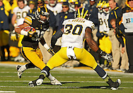 November 23 2013: Iowa Hawkeyes running back Jordan Canzeri (33) eyes Michigan Wolverines safety Thomas Gordon (30) on a run during the third quarter of the NCAA football game between the Michigan Wolverines and the Iowa Hawkeyes at Kinnick Stadium in Iowa City, Iowa on November 23, 2013. Iowa defeated Michigan 27-24. Iowa defeated Michigan 24-21.