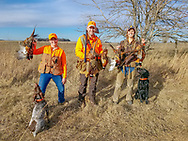 Julia Schrenkler (Left,) Matt Kucharski, and Emy Marier on a Minnesota pheasant hunt.<br />