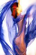 Woman in a whirl of blue cloth