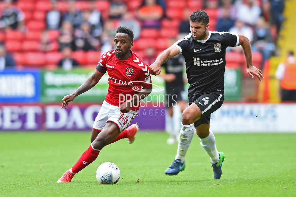 Charlton Athletic midfielder Tariqe Fosu (14) in action against Northampton Town midfielder Yaser Kasim (4) during the EFL Sky Bet League 1 match between Charlton Athletic and Northampton Town at The Valley, London, England on 19 August 2017. Photo by Jon Bromley.