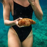 "Sammy ""Salt Siren"" free diving at Electric Beach, Oahu, Hawaii."