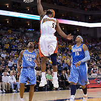 10 April 2008: #5 Baron Davis of the Golden State Warriors goes for the layup past Carmelo Anthony and Anthony Carter during the Denver Nuggets 114-105 victory over the Golden State Warriors at the Oracle Arena in Oakland, CA.