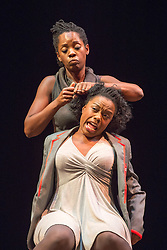 © Licensed to London News Pictures. 21/10/2013. Theatre Royal Stratford East presents Crowning Glory, a new play by Somalia Seaton that seeks to reveal a hidden world of unobtainable beauty by asking the question, how do women truly see themselves in today's world? Picture features (Front) Sheri-An Davis(Haircomb) & Rebecca Omogbehin (Bounty). Photo credit: Tony Nandi/LNP.