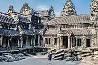 woman in the courtyard Angkor Wat temple Cambodia