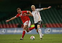Photo: Rich Eaton.<br /> <br /> Wales v Germany. UEFA European Championships Qualifying. 08/09/2007. Germany's Bastian Schweinsteiger (R)is tackled by Wales' Freddy Eastwood (L).