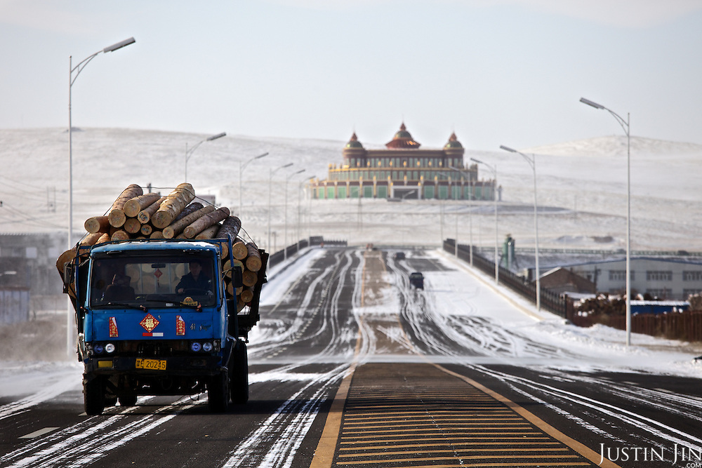Russian timber is processed in the Chinese boomtown of Manzhouli, near the Russian-Chinese border. The building in the back is the timber trade exchange. Much of the forests in Siberia and the Russian Far East is destroyed to feed the construction boom of its resource-hungry Asian neighbour.