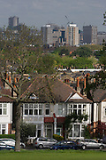 Edwardian houses in south London dominated in the distance by the MI6 Intelligence building at Vauxhall.