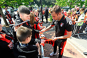 AFC Bournemouth defender Steve Cook signing his autograph for a fan on arrival for the Premier League match between Bournemouth and Burnley at the Vitality Stadium, Bournemouth, England on 13 May 2017. Photo by Graham Hunt.