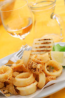 ".dining at a terrace on the island of Murano, Venice.fried squid..""calamari fritti""..7-2004.."