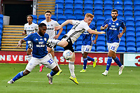 iFootball - 2019 / 2020 Championship - Play-off semi-final - 1st leg - Cardiff City vs Fulham<br /> <br /> Junior Hoilett of Cardiff City & Harrison Reed of Fulham<br /> in a match played with no crowd due to Covid 19 coronavirus emergency regulations, in an almost empty ground, at the Cardiff City Stadium<br /> <br /> COLORSPORT/WINSTON BYNORTH