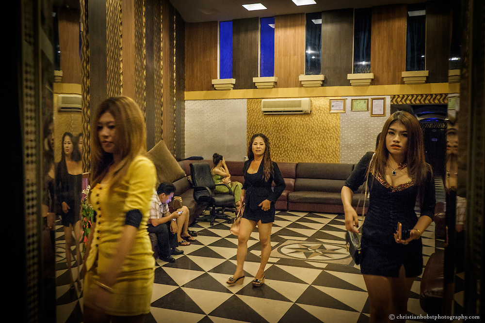 There are many barely dressed girls in the foyer of the karaoke bar, waiting to be booked as an escort to sing karaoke with, or more. Many parents sell their own children to the sex-industry because of the high poorness in Cambodia.
