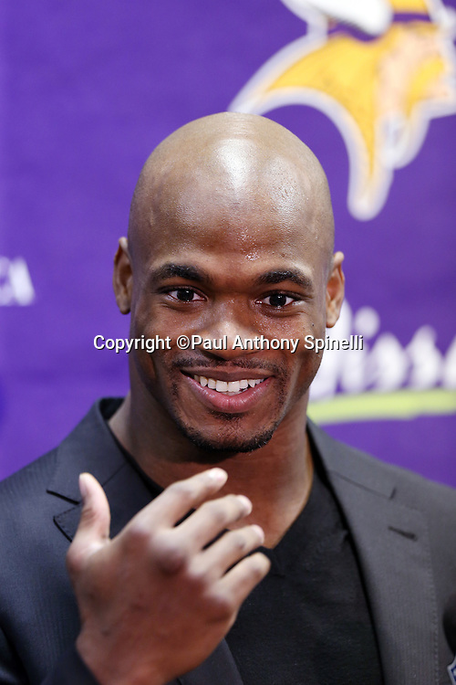 Minnesota Vikings running back Adrian Peterson (28) smiles and gestures as he makes a point while addressing the media in a post game press conference after the NFL week 15 football game against the St. Louis Rams on Sunday, Dec. 16, 2012 in St. Louis. The Vikings won the game 36-22. ©Paul Anthony Spinelli