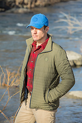 good looking middle aged man by a river