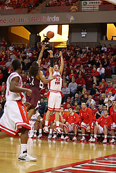 05 January 2008:  Levi Dyer gets off a shot ahead of a block attempt by Randal Falker.The Redbirds of Illinois State took the bite out of the Salukis of Southern Illinois winning the Conference home opener for the 'birds on Doug Collins Court in Redbird Arena in Normal Illinois by a score of 56-47.