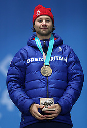 Great Britain's Billy Morgan celebrates with his Bronze medal during the Men's Snowboarding Big Air Final medal ceremony on day fifteen of the PyeongChang 2018 Winter Olympic Games in South Korea.