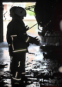 © licensed to London News Pictures. MARLOW, UK.  03/08/11. Firemen inspect the damage to the remaining boats. Marlow Rowing Club has been badly damaged by fire today (03 August 2011). Boats with an estimated value of 100,000 pounds have been damaged. Steve Redgrave, Olympic Rower, who trained at the club and is from Marlow said his daughters boat is believed to be inside.  Mandatory Credit Stephen Simpson/LNP