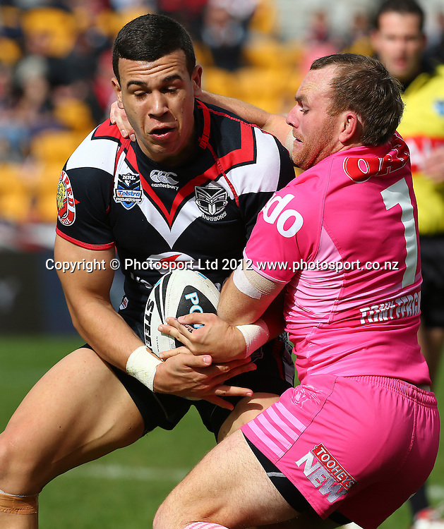 carlos Tuimavave of the Warriors is tackled during the NRL game, Vodafone Warriors v Penrith Panthers, Mt Smart Stadium, Auckland, Sunday 19 August  2012. Photo: Simon Watts /photosport.co.nz