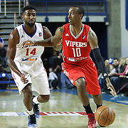 Rio Grande Valley Vipers Guard Jarvis Threatt (10) drives past Delaware 87ers Forward Malcolm Lee (14) on defense in the first half of a NBA D-league regular season basketball game between the Delaware 87ers and the Rio Grande Valley Vipers (Houston Rockets) Saturday, Dec. 27, 2014 at The Bob Carpenter Sports Convocation Center in Newark, DEL