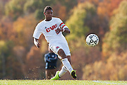 CVU's Trey Tomasi (25) kicks the ball down the field during the boys semifinal soccer game between Mount Anthony and Champlain Valley Union at CVU high school on Tuesday afternoon October 27, 2015 in Hinesburg. (BRIAN JENKINS/ for the FREE PRESS)