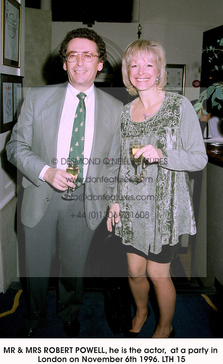 MR & MRS ROBERT POWELL, he is the actor,  at a party in London on November 6th 1996.LTH 15