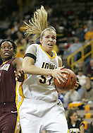 25 JANUARY 2007: Iowa forward Krista VandeVenter (51) drives to the basket in Iowa's 80-78 overtime loss to Minnesota at Carver-Hawkeye Arena in Iowa City, Iowa on January 25, 2007.
