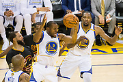 Golden State Warriors forward Andre Iguodala (9) snags a rebound during Game 2 of the NBA Finals against the Cleveland Cavaliers at Oracle Arena in Oakland, Calif., on June 4, 2017. (Stan Olszewski/Special to S.F. Examiner)