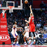 12 December 2016: Portland Trail Blazers center Mason Plumlee (24) goes for the baby hook over LA Clippers center DeAndre Jordan (6) and LA Clippers guard Chris Paul (3) during the LA Clippers 121-120 victory over the Portland Trail Blazers, at the Staples Center, Los Angeles, California, USA.