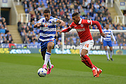 Reading's Nick Blackman holds off Charlton Athletic striker Karlan Ahearne-Grant during the Sky Bet Championship match between Reading and Charlton Athletic at the Madejski Stadium, Reading, England on 17 October 2015. Photo by Mark Davies.