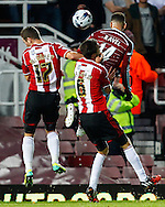 Ravel Morrison of West Ham United (centre) beats Harrison McGahey of Sheffield United (left) and Chris Basham of Sheffield United to head the ball goalwards during the Capital One Cup match at the Boleyn Ground, London<br /> Picture by David Horn/Focus Images Ltd +44 7545 970036<br /> 26/08/2014