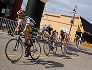 Cyclists exit turn 4 while competing in the masters cat 1/2/3 race of the 2014 Duluth Georgia Cup cycling event on Saturday in Duluth. (Staff Photo: David Welker)