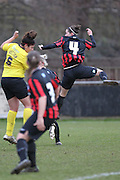 Deanna Cooper leaps before Renne Hector can clear during the Women's FA Cup match between Watford Ladies FC and Brighton Ladies at the Broadwater Stadium, Berkhampstead, United Kingdom on 1 February 2015. Photo by Stuart Butcher.