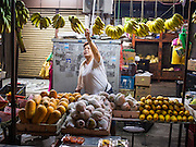 07 OCTOBER 2014 - GEORGE TOWN, PENANG, MALAYSIA: A woman sets up her banana stand in a market in George Town (also Georgetown), the capital of the state of Penang in Malaysia. Named after Britain's King George III, George Town is located on the north-east corner of Penang Island. The inner city has a population of 720,202 and the metropolitan area known as George Town Conurbation which consists of Penang Island, Seberang Prai, Kulim and Sungai Petani has a combined population of 2,292,394, making it the second largest metropolitan area in Malaysia. The inner city of George Town is a UNESCO World Heritage Site and one of the most popular international tourist destinations in Malaysia.         PHOTO BY JACK KURTZ
