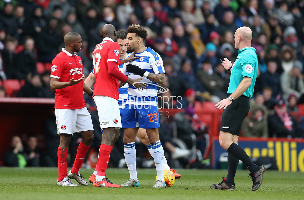 Charlton Athletic midfielder Alou Diarra (12) and Reading midfielder Daniel Williams (23) square up during the Sky Bet Championship match between Charlton Athletic and Reading at The Valley, London, England on 27 February 2016.