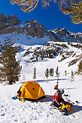 Yellow dome tent and backcountry skier, Inyo National Forest, Sierra Nevada Mountains, California