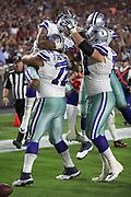 Dallas Cowboys wide receiver Brice Butler (19) gets a lift in the air from Dallas Cowboys center Travis Frederick (72) as he celebrates with teammates after catching a 37 yard touchdown pass for a 21-14 third quarter Cowboys lead during the 2017 NFL week 3 regular season football game against the against the Arizona Cardinals, Monday, Sept. 25, 2017 in Glendale, Ariz. The Cowboys won the game 28-17. (©Paul Anthony Spinelli)
