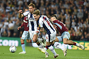 West Bromwich Albion midfielder (on loan from Fulham) Stefan Johansen (6) fouls Aston Villa midfielder Jack Grealish (10) during the EFL Sky Bet Championship play-off second leg match between West Bromwich Albion and Aston Villa at The Hawthorns, West Bromwich, England on 14 May 2019.